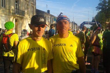 Michel aux côtés de son guide pour le marathon du Médoc